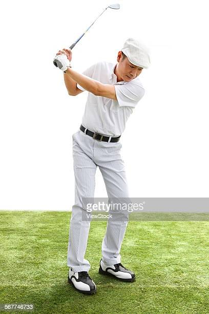A middle-aged man is playing golf