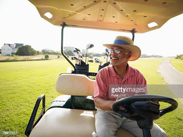Middle-Aged Man Riding a Golf Cart