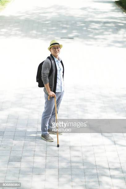 Middle-aged man standing in the park