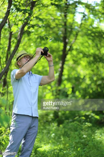 middle-aged man taking a photo