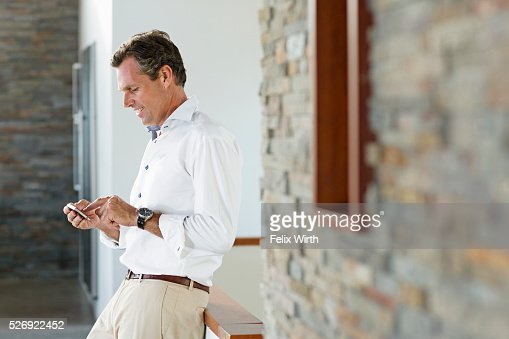 Middle-aged man texting : Stock Photo