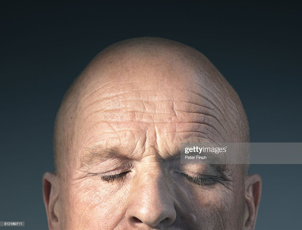 Middle-aged man's face with eyes closed : Stock Photo
