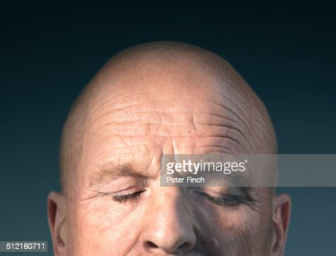 Middle-aged man's face with eyes closed