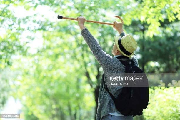 Middle-aged men who have high canes with both hands