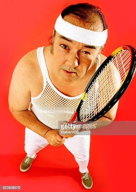 Middle-aged tennis player looking exhausted