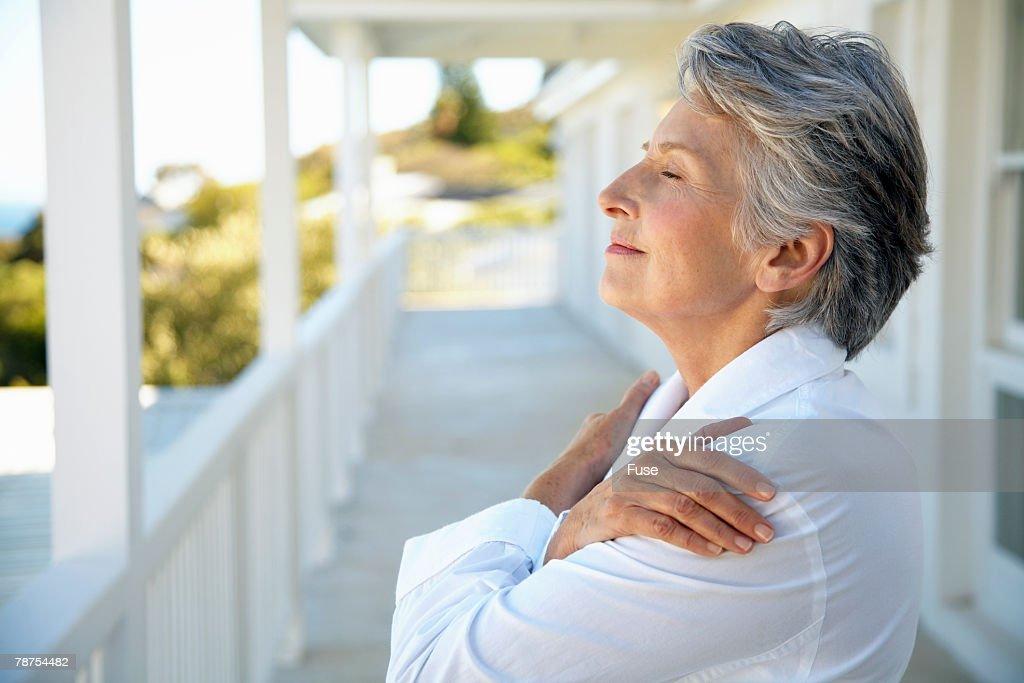 Middle-Aged Woman Enjoying Fresh Air