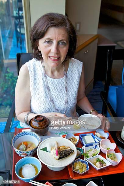 Middle-aged woman enjoying Japanese breakfast