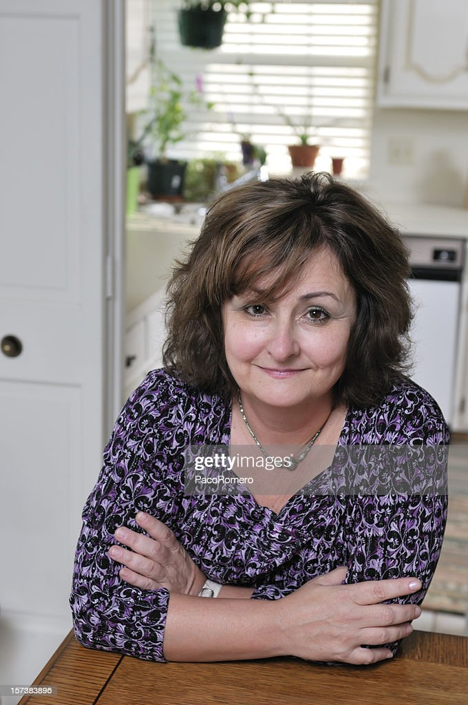 Middle-aged woman in kitchen