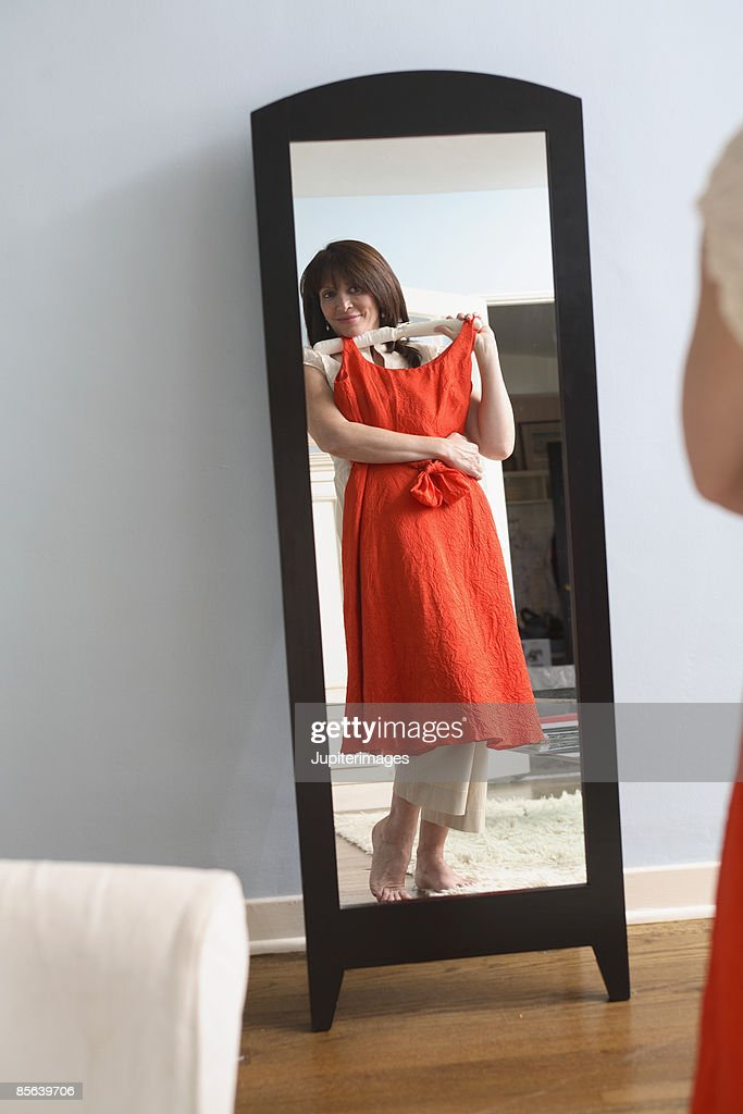 Middle-aged woman looking in mirror