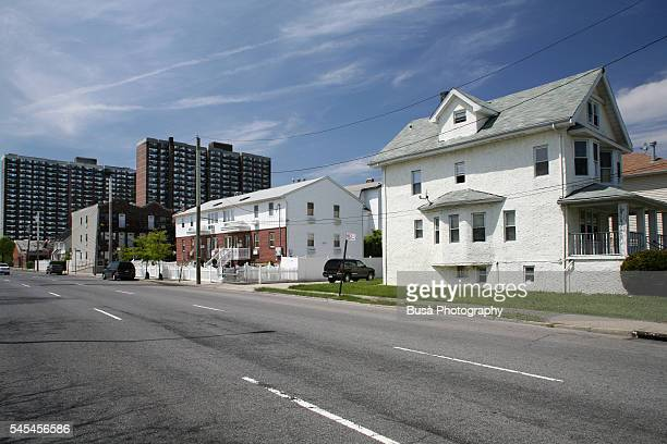 Middle-class single-family houses with public housing projects in the background the Rockaways, Queens, New York City