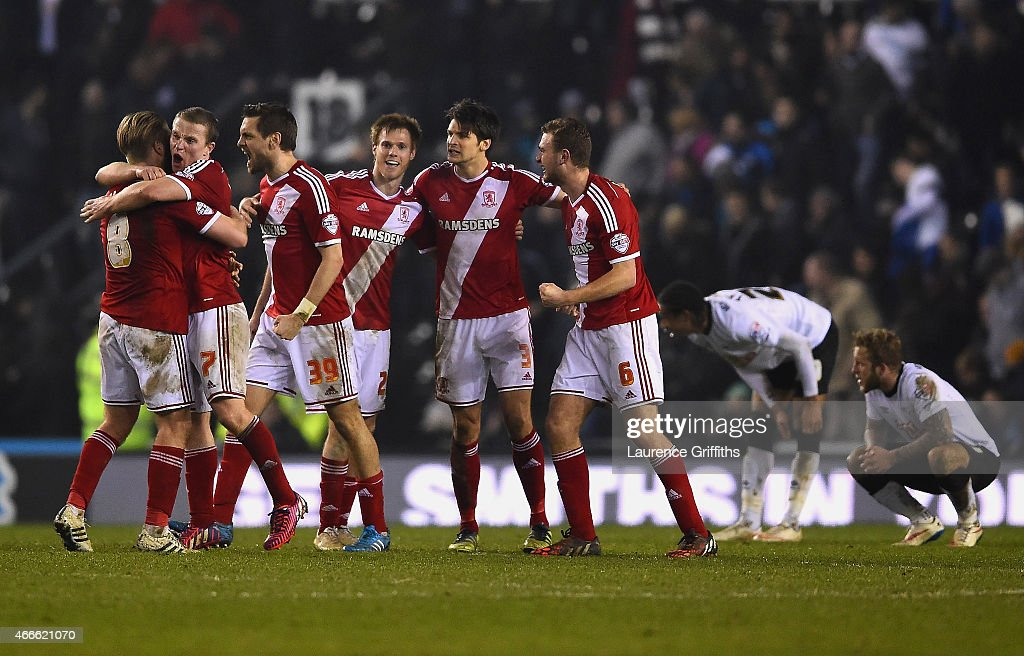 Middlesborough celebrate victory after the Sky Bet Championship match between Derby County and Middlesbrough at iPro Stadium on March 17, 2015 in Derby, England.