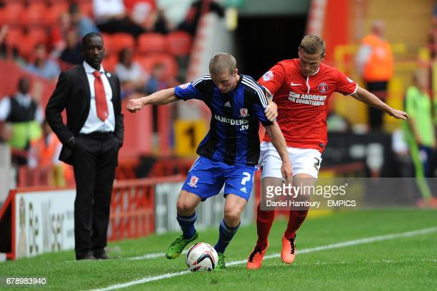Middlesborough's Grant Leadbitter and Charlton Athletic's Mark Gower battle for the ball as Chris Powell looks on