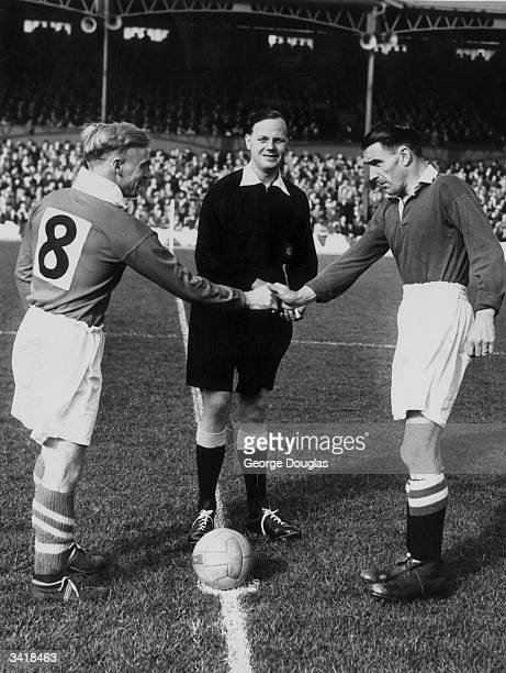 Middlesbrough captain Wilf Mannion shakes hands with Chelsea captain Campbell before the kick off as Chelsea play Middlesbrough Original Publication...