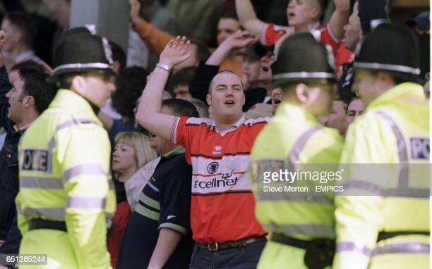 A Middlesbrough fan celebrates after Christian Karembeu gives Middlesbrough a life line in the relegation battle