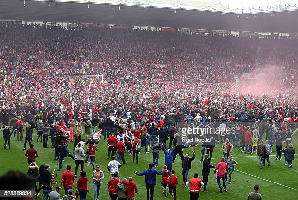 Middlesbrough fans invade the pitch after the Sky Bet Championship match between Middlesbrough and Brighton and Hove Albion at the Riverside Stadium...