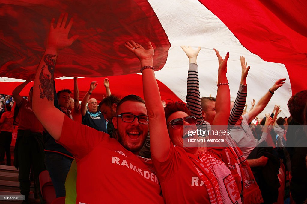 Middlesbrough fans raise a giant flag during the Premier League match between Middlesbrough and Tottenham Hotspur at the Riverside Stadium on September 24, 2016 in Middlesbrough, England.