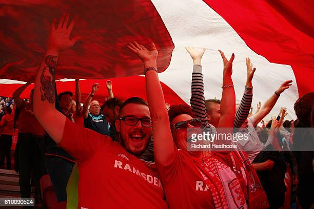 Middlesbrough fans raise a giant flag during the Premier League match between Middlesbrough and Tottenham Hotspur at the Riverside Stadium on...