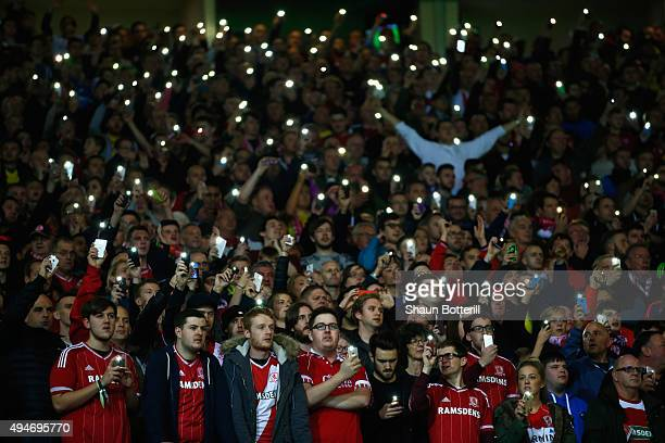 Middlesbrough fans shine the torch on their mobile phones during the Capital One Cup Fourth Round match between Manchester United and Middlesbrough...