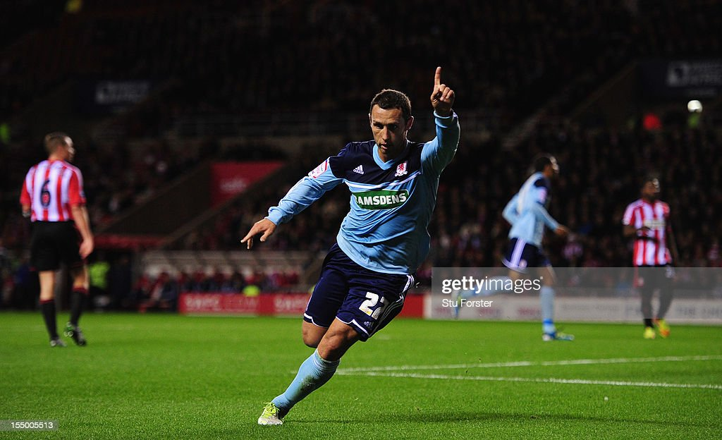 Middlesbrough forward <a gi-track='captionPersonalityLinkClicked' href=/galleries/search?phrase=Scott+Mcdonald&family=editorial&specificpeople=2181301 ng-click='$event.stopPropagation()'>Scott Mcdonald</a> celebrates his opening goal during the Capital One Cup Fourth Round match between Sunderland and Middlesbrough at Stadium of Light on October 30, 2012 in Sunderland, England.