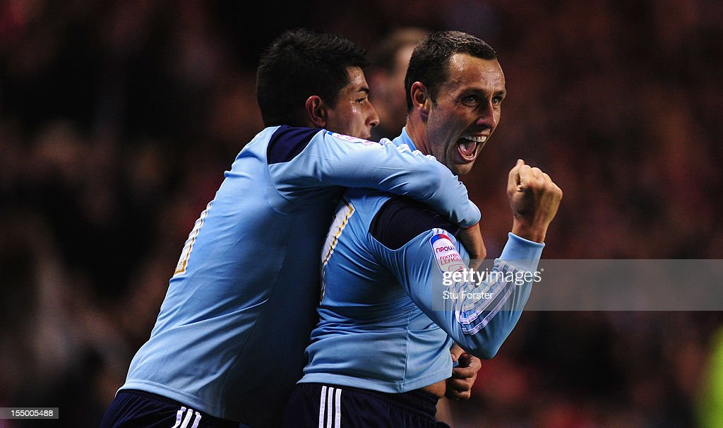 Middlesbrough forward <a gi-track='captionPersonalityLinkClicked' href=/galleries/search?phrase=Scott+Mcdonald&family=editorial&specificpeople=2181301 ng-click='$event.stopPropagation()'>Scott Mcdonald</a> (front) celebrates his opening goal with Emmanuel Ledesma during the Capital One Cup Fourth Round match between Sunderland and Middlesbrough at Stadium of Light on October 30, 2012 in Sunderland, England.