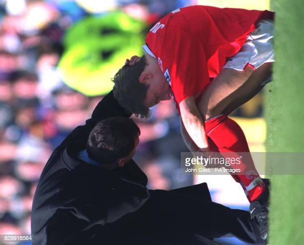 Middlesbrough manager Bryan Robson consoles Juninho after their side was relegated from the Premeiship after drawing at Leeds todayPhoto JOHN GILESPA
