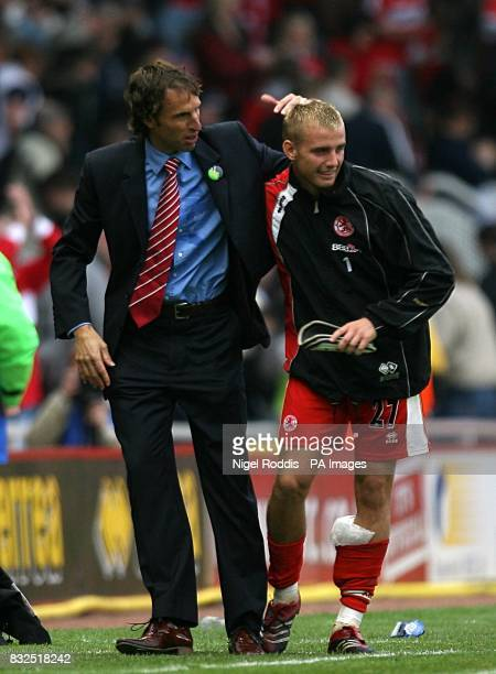 Middlesbrough manager Gareth Southgate congratulates Lee Cattermole at the final whistle