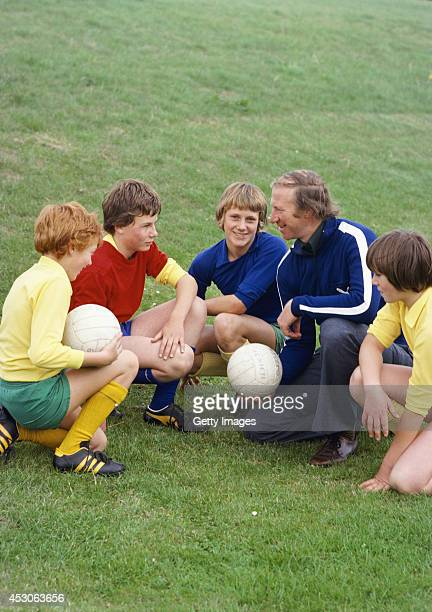 Middlesbrough manager Jack Charlton chats with a group of boys circa 1977