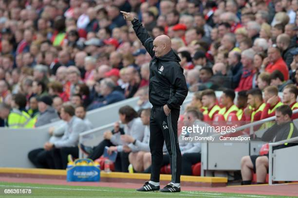 Middlesbrough manager Steve Agnew shouts instructions to his team from the dugout during the Premier League match between Liverpool and Middlesbrough...