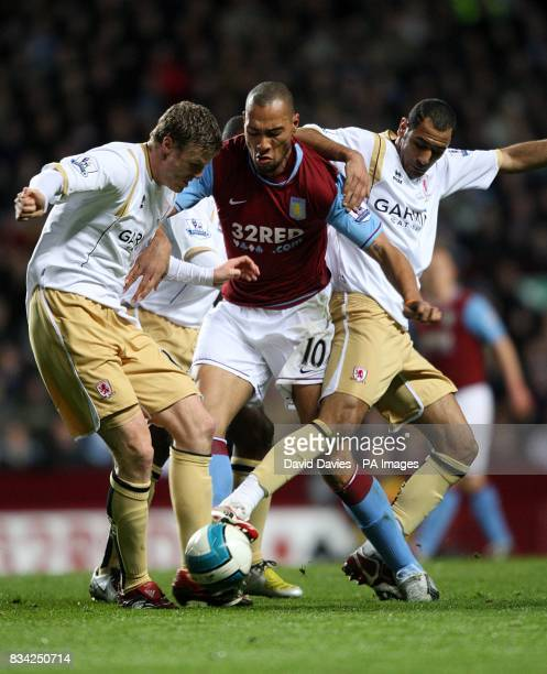Middlesbrough Mohamed Shawky and Robert Huth trie to win the ball off Aston Villa's John Carew
