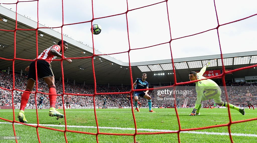 Middlesbrough player Christian Stuani scores the second goal despite the efforts of Sunderland defender Patrick van Aanholt on the line during the Premier League match between Sunderland and Middlesbrough at Stadium of Light on August 21, 2016 in Sunderland, England.