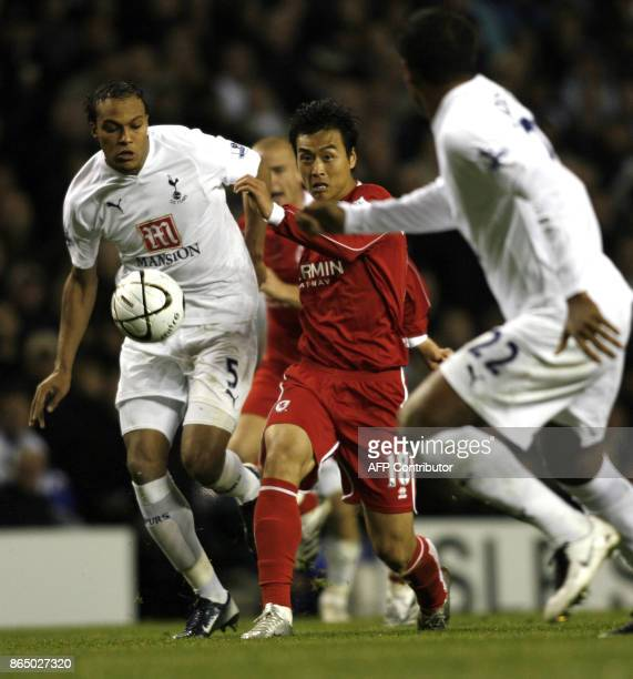 Middlesbrough player Dong Cook Lee holds off Tottenham player Younes Kaboul during the Carling Cup third round match at White Hart Lane in East...