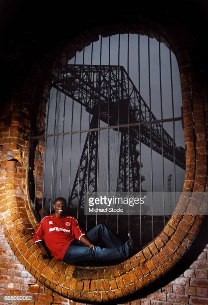 Middlesbrough player George Boateng pictured infront of the Tees Transporter Bridge during a feature shoot on August 22 2002 in Middlesbrough England