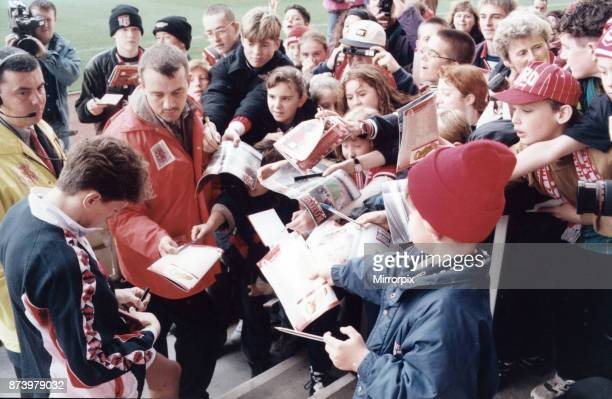 Middlesbrough player Juninho is mobbed by fans at the Riverside Stadium before the official opening match against Sampdoria 12th November 1995