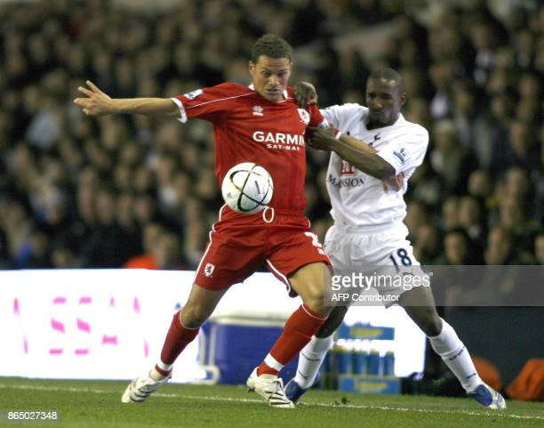 Middlesbrough player Luke Young is tackled by Tottenham player Jermaine Defoe during the Carling Cup third round match at White Hart Lane in East...