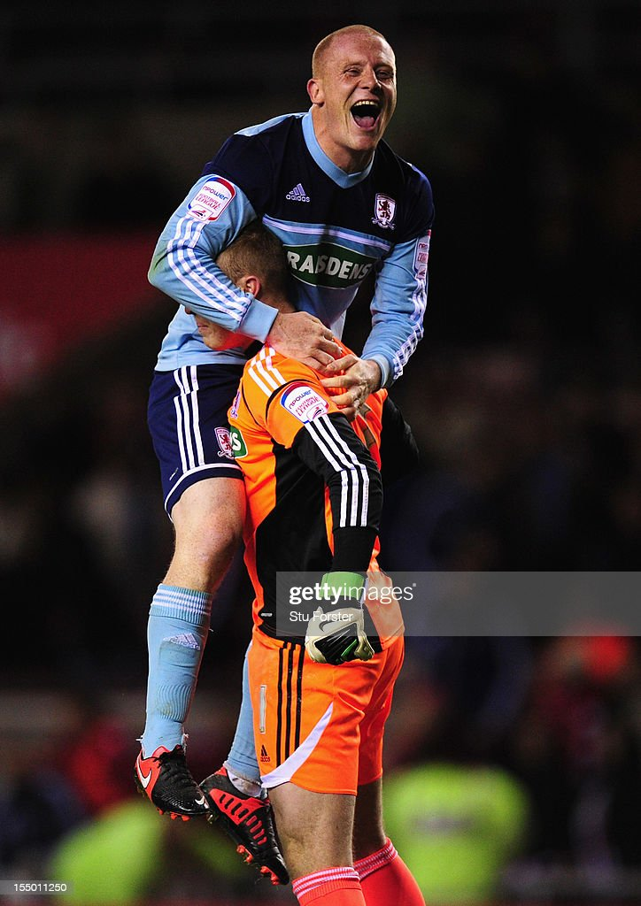 Middlesbrough player Nicky Bailey (top) celebrates with keeper Jason Steele after the Capital One Cup Fourth Round match between Sunderland and Middlesbrough at Stadium of Light on October 30, 2012 in Sunderland, England.
