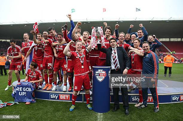 Middlesbrough players and staffs celebrate their promotion to the Premier League after the Sky Bet Championship match between Middlesbrough and...
