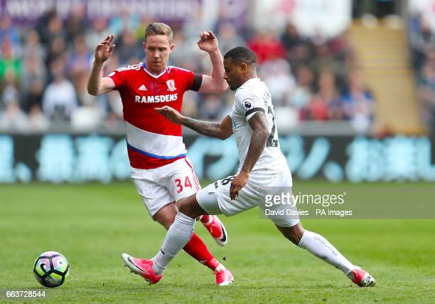 Middlesbrough's Adam Forshaw and Swansea City's Luciano Narsingh battle for the ball during the Premier League match at the Liberty Stadium Swansea