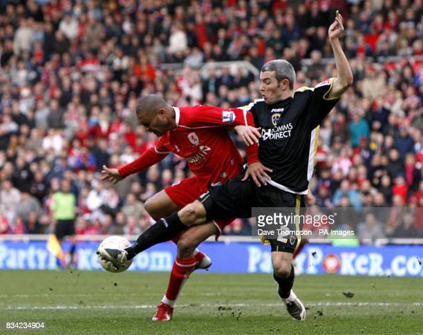 Middlesbrough's Afonso Alves and Cardiff City's Kevin McNaughton battle for the ball