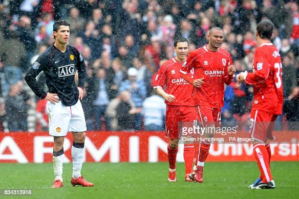 Middlesbrough's Afonso Alves celebrates scoring the third goal of the match with team mates as Manchester United's Cristiano Ronaldo stands dejected