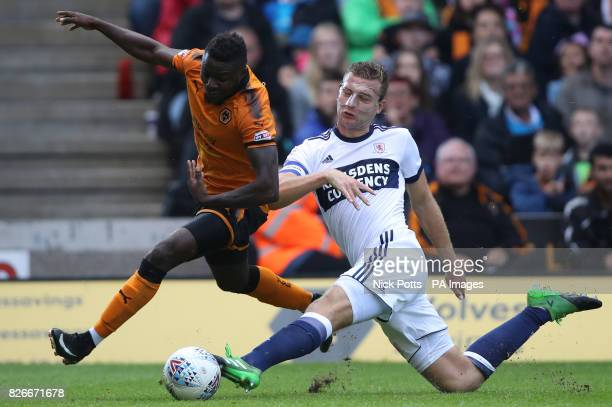 Middlesbrough's Ben Gibson and Wolverhampton Wanderers' Bright Enobakhare battle for the ball during the Sky Bet Championship match at Molineux...