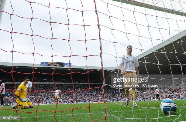 Middlesbrough's Brad Jones sits on the floor and Luke Young picks the ball from the goal after sunderlands Michael Chopra scored during the Barclays...