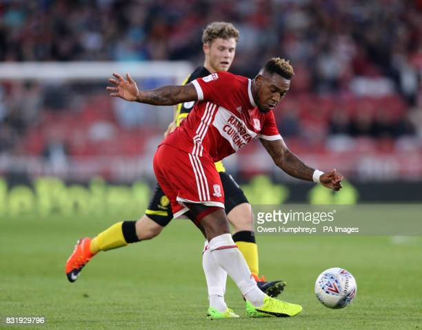 Middlesbrough's Britt Assombalonga and Burton Albion's Damien McCrory battle for the ball during the Sky Bet Championship match at the Riverside...