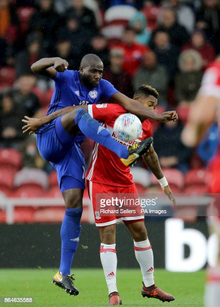 Middlesbrough's Britt Assombalonga and Cardiff City's Sol Bamba challenge during the Sky Bet Championship match at the Riverside Stadium Middlesbrough