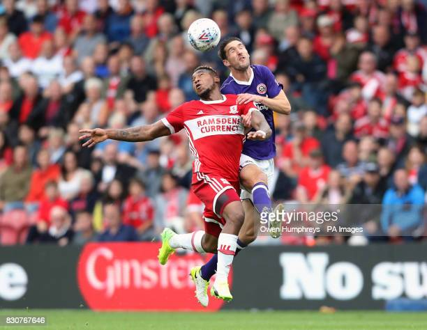 Middlesbrough's Britt Assombalonga and Sheffield United's Chris Basham battle for the ball during the Sky Bet Championship match at the Riverside...