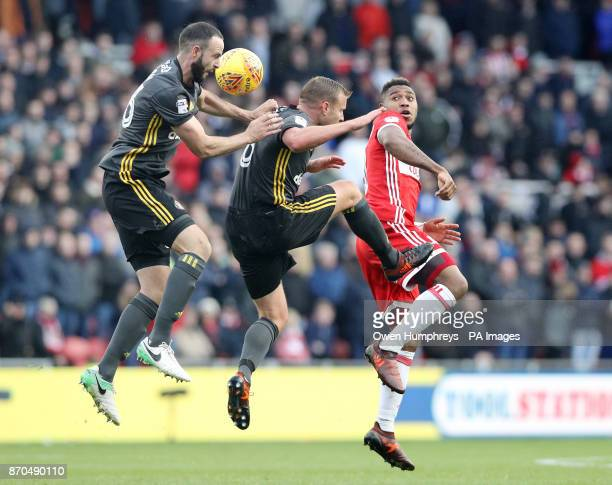 Middlesbrough's Britt Assombalonga battles with Sunderland's Lee Cattermole and Marc Wilson during the Sky Bet Championship match at Riverside...