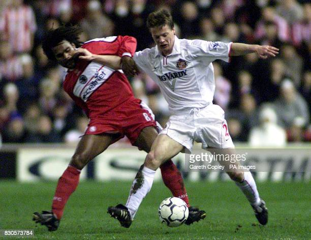LEAGUE Middlesbrough's Christian Karembeu is held off by Sunderland's Stefan Schwarz during FA Carling Premiership match at Riverside Stadium...