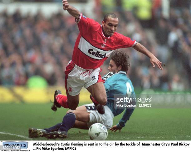 Middlesbrough's Curtis Fleming is sent in to the air by the tackle of Manchester City's Paul Dickov