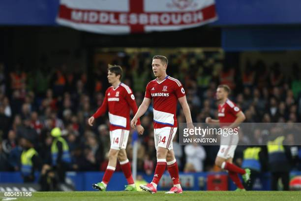 Middlesbrough's Dutch midfielder Marten de Roon and Middlesbrough's English midfielder Adam Forshaw react after Chelsea's Brazilianborn Spanish...