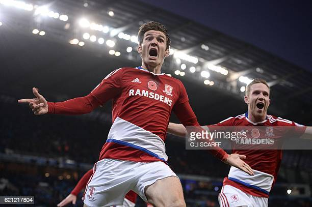 Middlesbrough's Dutch midfielder Marten de Roon celebrates scoring a late equalising goal for 11 during the English Premier League football match...
