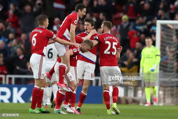 Middlesbrough's Dutch midfielder Marten de Roon celebrates with teammates after scoring the opening goal of the English Premier League football match...